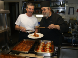 Photo: Friar Epifanios: cooking for journalists and other invited guests